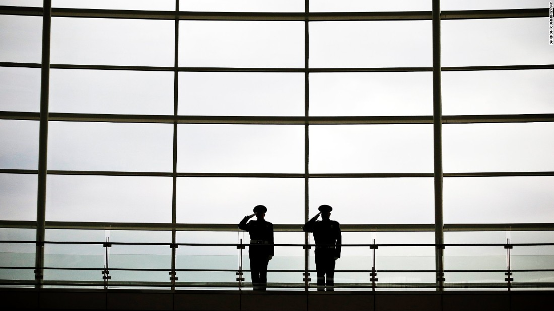 Honor guards salute during the national anthem in a 9/11 ceremony Friday at Indianapolis International Airport.