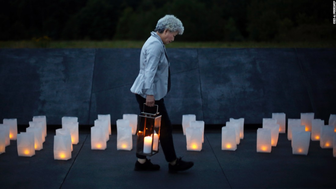 Yachiyo Kuge carries a lantern to place  at the Wall of Names at the Flight 93 National Memorial in Shanksville, Pennsylvania, on Thursday, September 10. Kuge is the mother of Toshiya Kuge, a Japanese passenger who died on United Airlines Flight 93 on 9/11. The plane crashed in Pennsylvania as passengers and crew tried to overcome the hijackers.