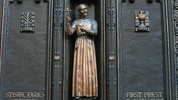 This is a statue of St. Isaac Jogues, thought to be the first Catholic priest to go to Manhattan, at New York City's St. Patrick's Cathedral. He is best known for his work as a missionary to the Huron and Algonquian nations in the area colonized by France in what is now the United States and Canada.  Jogues, who died in 1646 after he was hit with a Mohawk tomahawk, is the patron saint of the Americas and Canada.
