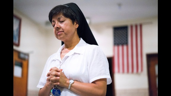 "Sister Sonia Avi, a fluent speaker of Spanish and English who hails from Lima, Peru, is trying to be a bridge between two cultures as Saint Charles Borromeo and Our Lady of Fatima merge. ""I hear them say, 'We've done this for so long,' and I see and hear a little differently than everybody else,"" she says. ""I want them to feel that God is a little more inclusive."""