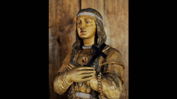 This is a wooden statue of St. Kateri Tekakwitha, a 17th-century Mohawk woman who was canonized in 2012. She is best known for teaching prayers to children and working with the elderly and sick. St. Kateri died in 1680, just before her 24th birthday. She is the Roman Catholic Church's first Native American saint.
