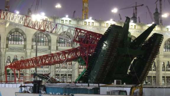 MECCA, SAUDI ARABIA - SEPTEMBER 11: At least 52 worshippers are killed and others injured when storms caused a crane to fall in Mecca's Grand Mosque on Friday, September 11, 2015. Millions of Muslim converge on Mecca to perform the sacred pilgrimage. A huge construction crane buffeted by strong winds collapsed and crashed through the roof of the Grand Mosque in Mecca Friday, the Saudi Arabia Civil Defense reports. Search and rescue teams and medical workers from the Saudi Red Crescent have been sent to the scene. (Photo by Ozkan Bilgin/Anadolu Agency/Getty Images)