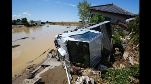 A truck and a house are damaged in Joso on September 11.