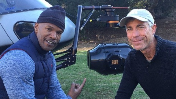 Pilot Alan Purwin, on right, seen here with actor Jamie Foxx, died in Colombia after the shooting of a Tom Cruise movie