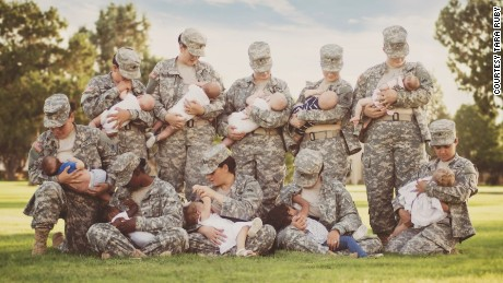 Soldiers pose for photo breast-feeding their children