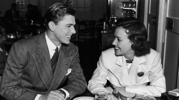 After starting out as a radio sports broadcaster, Reagan worked his way into the acting profession. Here, he sits with actress Margaret Lindsay in the Warner Brothers Studio commissary in 1935.