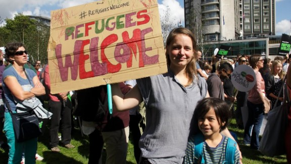 Thousands of people march in solidarity with refugees during a rally in London on September 12.