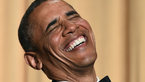 Barack Obama laughs as he listens to performer Joel McHale telling jokes during the White House Correspondents Association Dinner on May 3, 2014 in Washington, DC.