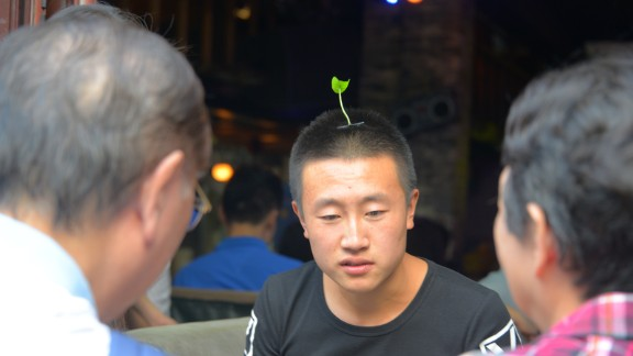 A bartender wears a sprout hair clip in Beijing