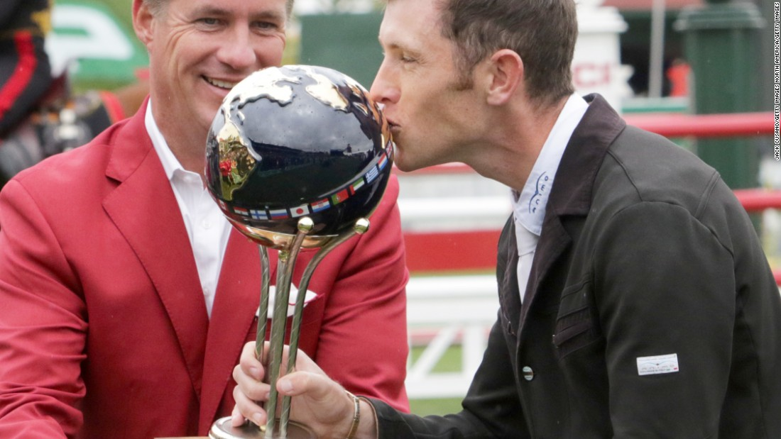 The world No.1 kisses the CP International Grand Prix trophy, and joins fellow Brit Pippa Funnel as the only other rider to win a grand slam in equestrian.