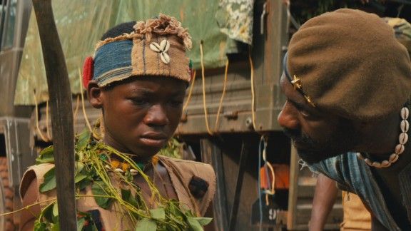 Elba plays a brutal warlord who forces child soldier named Agu, (Attah) to become a killer.