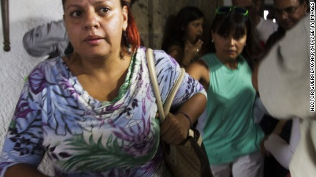"Relatives of Mexican tourists attacked in Egypt leave towards the airport in Guadalajara, Mexico on September 14, 2015. Egyptian security forces have mistakenly killed 12 people including Mexican tourists while chasing jihadists in the vast Western Desert, sparking condemnation of what Mexico called a ""deplorable"" air attack. Mexico called on Egypt Monday to swiftly investigate why tourists were mistakenly targeted in what witnesses described as an air strike that left at least two Mexicans dead and six unaccounted for. AFP PHOTO/HECTOR GUERRERO"