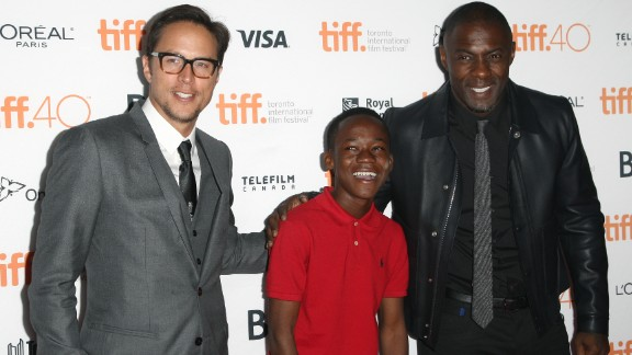"""The 14-year-old had the lead role in """"Beasts Of No Nations,"""" a film by Cary Fukunaga (left), also starring Idris Elba."""