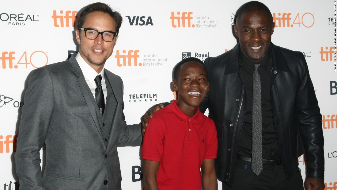 "The 14-year-old had the lead role in ""Beasts Of No Nations,"" a film by Cary Fukunaga (left), also starring Idris Elba."