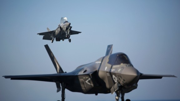 Two F-35B Lightning II fighters complete vertical landings aboard the amphibious assault ship USS Wasp during the opening day of the first session of operational testing in May 2015. As the future of Marine Corps aviation, the F-35B is designed to eventually replace all aircraft from three legacy Marine Corps platforms; the AV-8B Harrier, the F/A-18 Hornet, and the EA-6B Prowler.