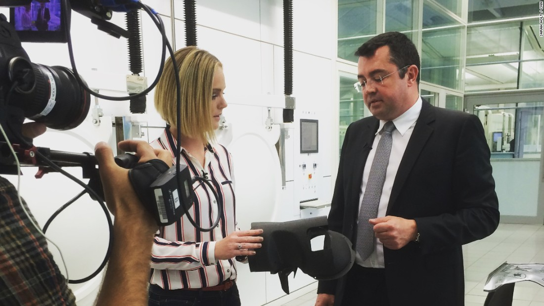 "McLaren racing director Eric Boullier shows CNN sports anchor Amanda Davies some of the carbon fiber parts used to build an F1 car. ""3D printing is something we are looking at for the future to make more complex parts,"" Boullier tells CNN."
