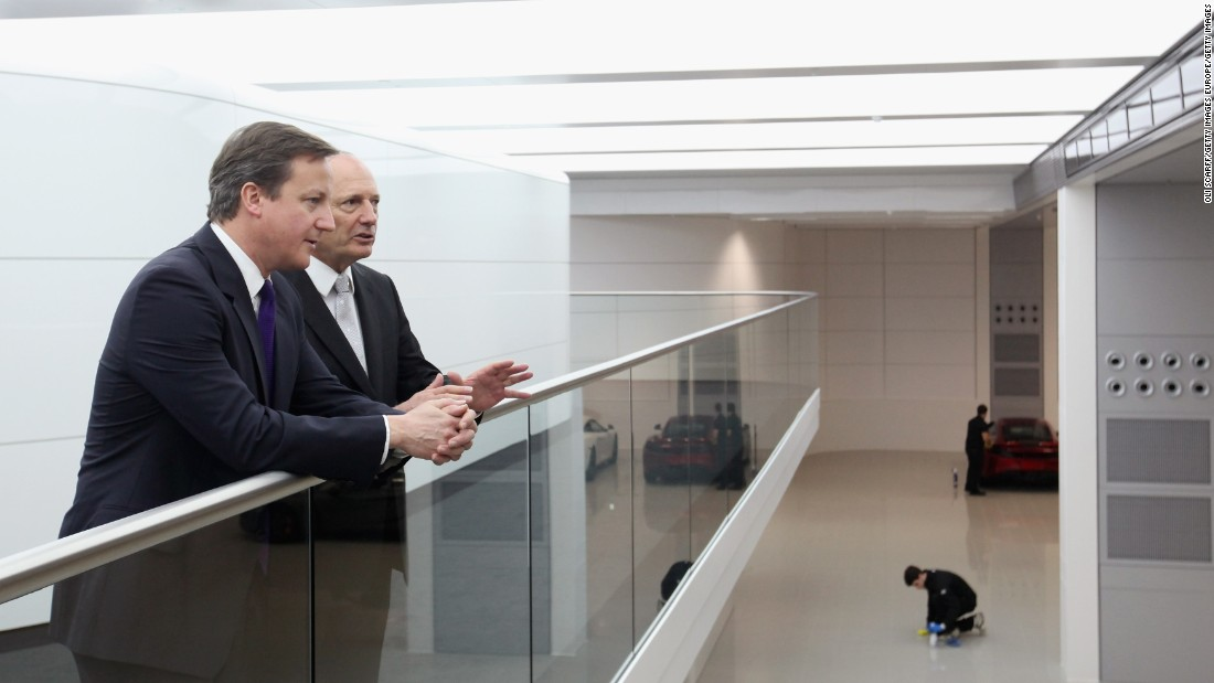 British Prime Minister David Cameron chats with Ron Dennis, the Executive Chairman of McLaren Automotive, during a visit to the McLaren Technology Centre (MTC) in 2011. Dennis wants the MTC to showcase the best of British engineering and technology.