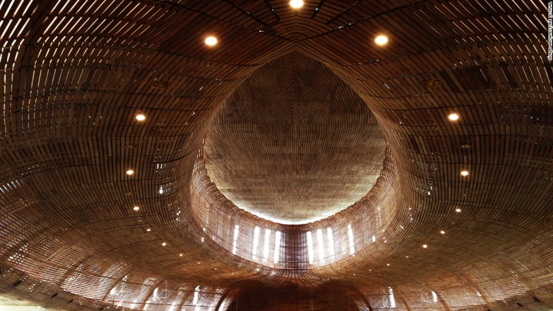 "This church's design is made of three concentric ovals and its warm, intimate interior is lined with timber. Teak wood slats are horizontally secured onto steel frames. Director of the Indonesian branch of Denton Corker Marshall, Budiman Hendropurnomo says the use of these materials and structure of design are intended to create acoustics that ""would have the likeness of singing inside a violin."""