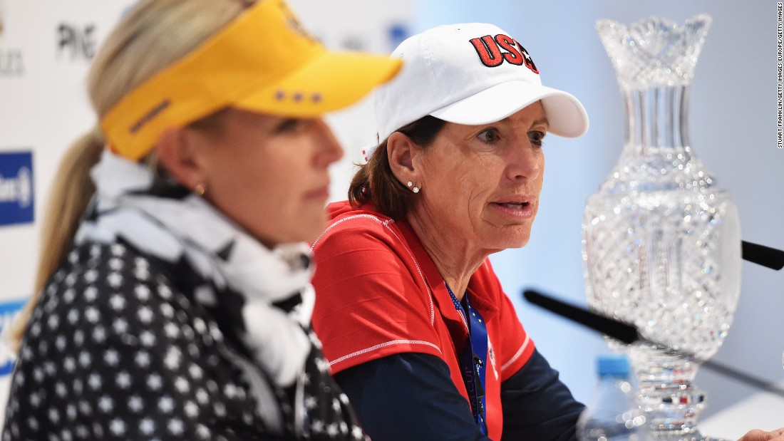European captain Carin Koch (L) and her American counterpart Inkster, face the cameras with the Solheim Cup prior to the event at St. Leon-Rot Golf Club.