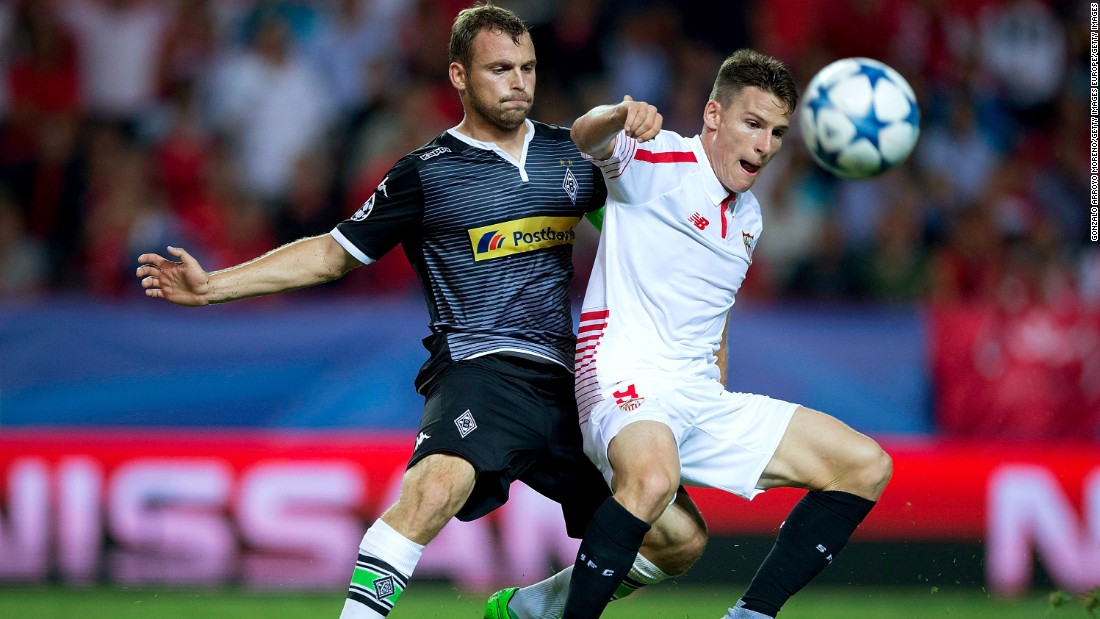 Kevin Gameiro (R) of Sevilla FC competes for the ball with Tony Jantschke (L) of Borussia Monchengladbach during the UEFA Champions League Group D match between Sevilla FC and VfL Borussia Monchengladbach at Estadio Ramon Sanchez Pizjuan on September 15, 2015 in Seville, Spain.