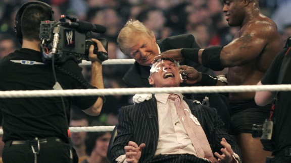 DETROIT - APRIL 1: WWE chairman Vince McMahon (C) has his head shaved by Donald Trump (L) and Bobby Lashley (R) after losing a bet in the Battle of the Billionaires at the 2007 World Wrestling Entertainment