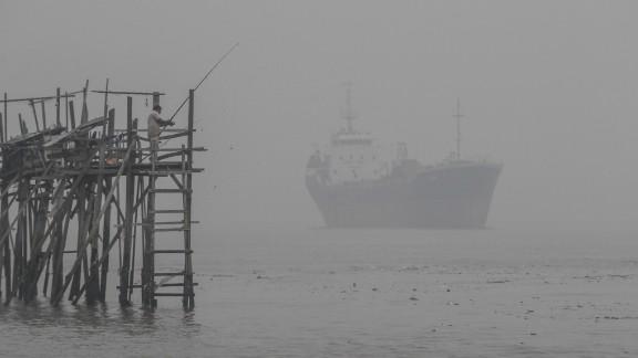 A man fishes in haze-hit Port Klang, outside Kuala Lumpur, on September 13.