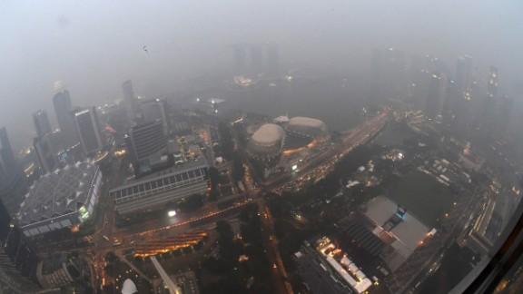 City lights pierce through the dense haze in Singapore on September 14, 2015.