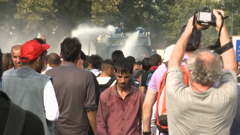 Tear gas and water cannons used on migrants at border