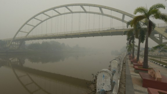 Cars drive through a bridge over the Siak river in Riau, Indonesia, on September 13, 2015. Indonesia declared a state of emergency in Sumatra