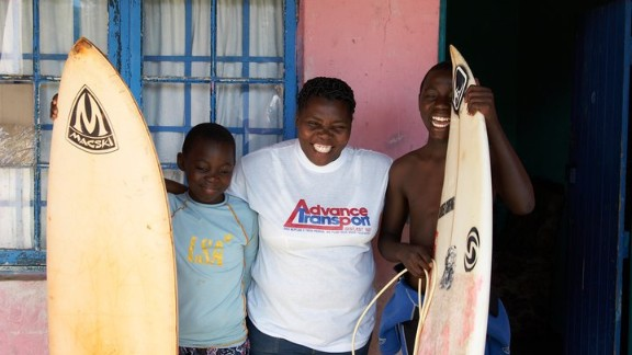 Avo, right, with his mother, Ntombodumo Ndamase, and brother Zama, who was fatally attacked by a shark in 2011.