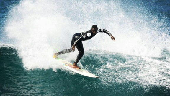 """Ayuvile """"Avo"""" Ndamase is one of South Africa's best-known young surfers. He was only six when he first surfed. Today he is an aspiring competitive surfer."""