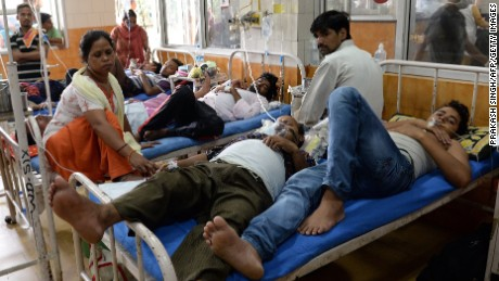Patients share beds at Hindu Rao Hospital in New Delhi on September 16, 2015.