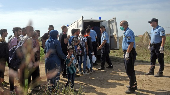 Croatian police officers round-up migrants and refugees near the village of Tovarnik, close to the official Serbia-Croatia border on September 16, 2015. Migrants and refugees began to cross from Serbia into Croatia, desperate to find a new way into the European Union after Hungary sealed its border and a string of EU countries tightened frontier controls in the face of an unprecedented human influx. AFP PHOTO / ALEXA STANKOVICALEXA STANKOVIC/AFP/Getty Images