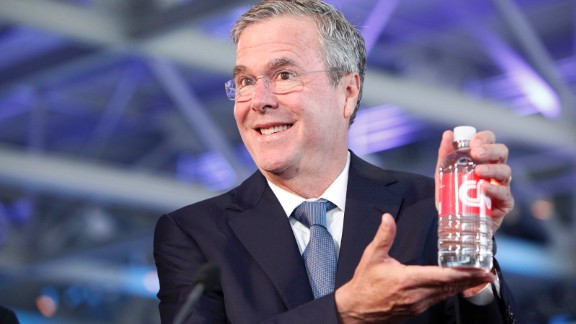 Bush poses with CNN-labeled water in the hours before the event.