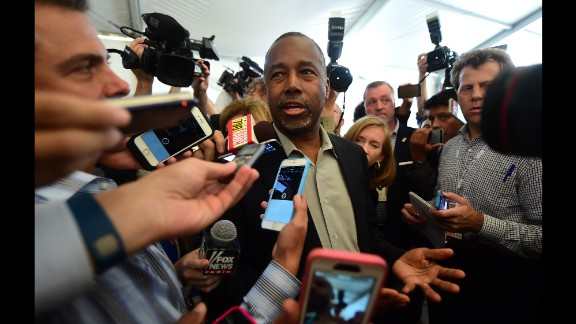 Carson answers reporters