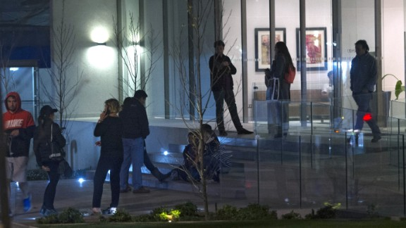 People remain outside a building during a strong quake in Santiago on September 16, 2015. A strong 7.2-magnitude earthquake struck the center of Chile on Wednesday, local seismologists said, triggering a tsunami alert, sparking panic and shaking buildings. AFP PHOTO /VLADIMIR RODAS        (Photo credit should read VLADIMIR RODAS/AFP/Getty Images)