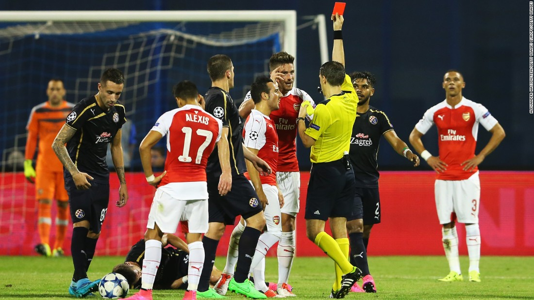 Arsenal striker Olivier Giroud is shown the red card by referee Ovidiu Hategan at Dinamo Zagreb as the London club slumped to defeat.