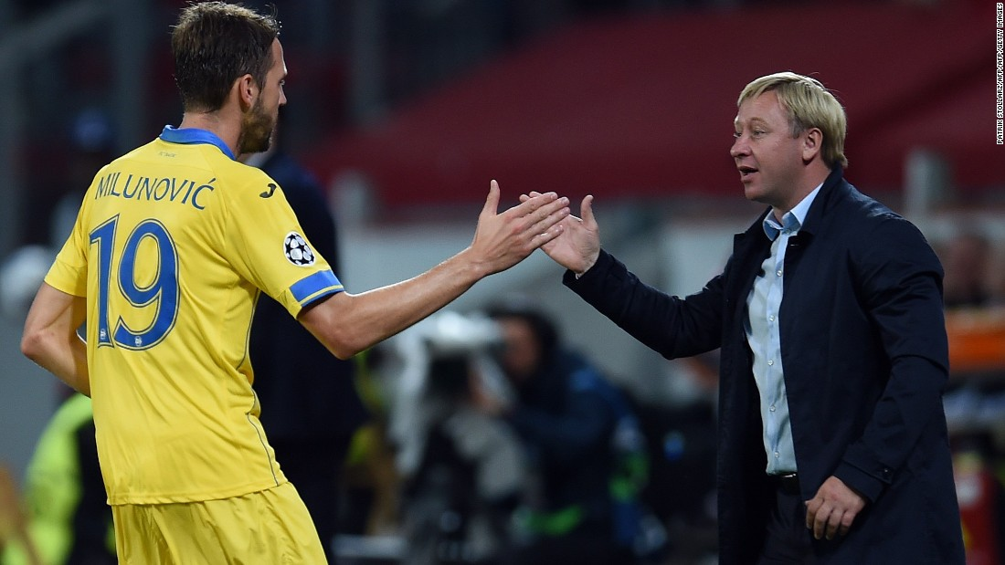 BATE Borisov forward Dmitri Mozolevski celebrates with coach Aleksandr Yermakovich after scoring at Bayer Leverkusen -- but his efforts proved to be in vain.
