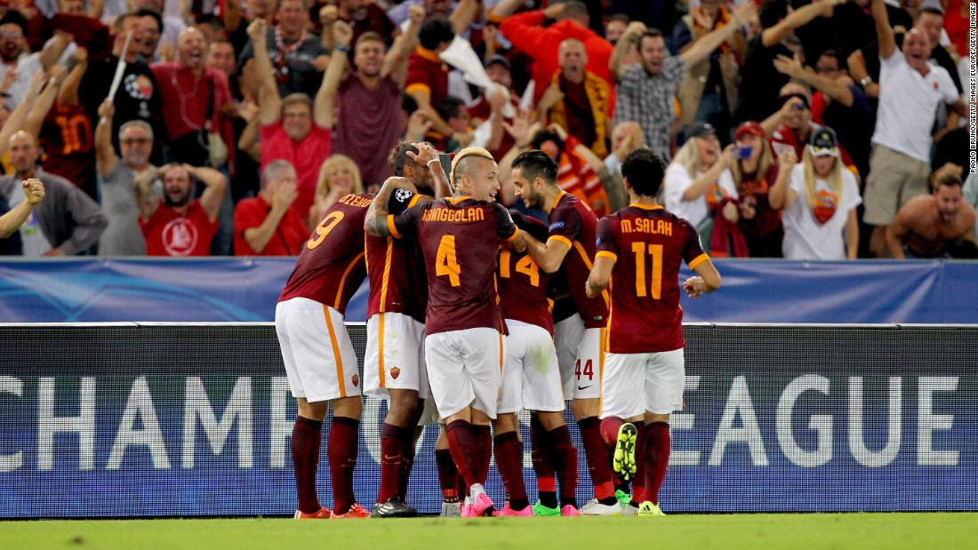 Roma players and fans celebrate the spectacular Florenzi goal, from almost 60 yards out wide on the right, that leveled against Barca.