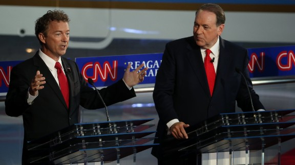 Paul and Huckabee participate in the debate.