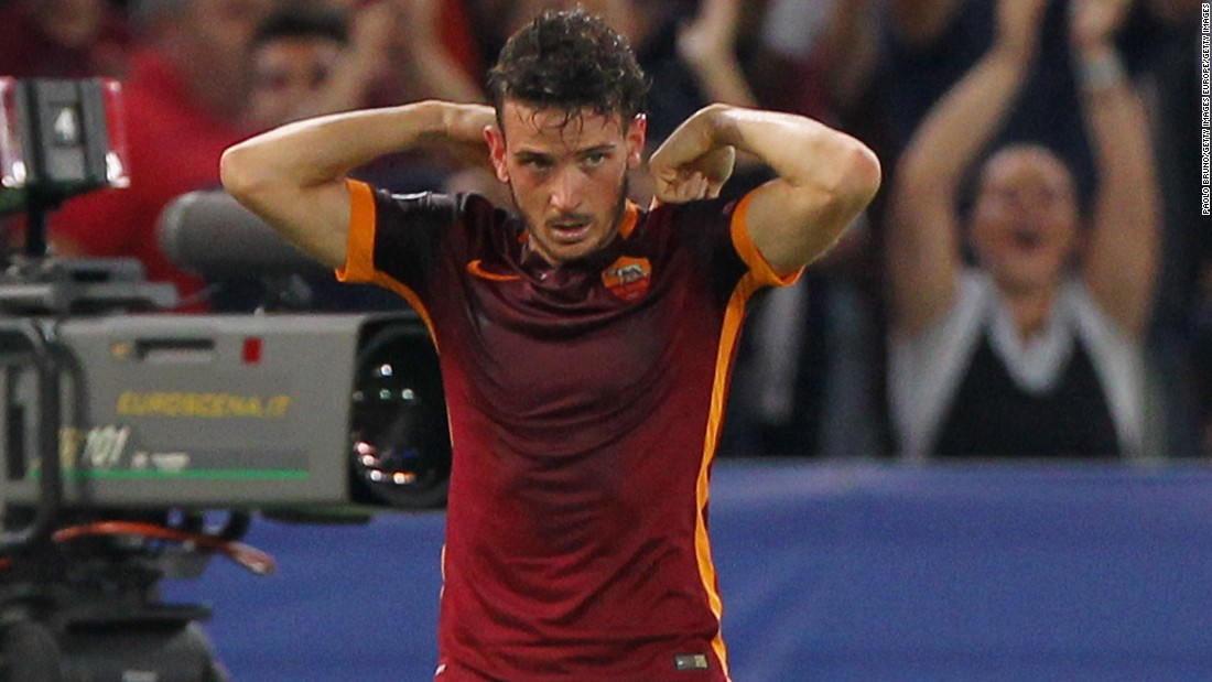 Alessandro Florenzi of AS Roma celebrates by pointing to the name on the back of his shirt after his sensational equalizer against Barcelona in the Champions League.