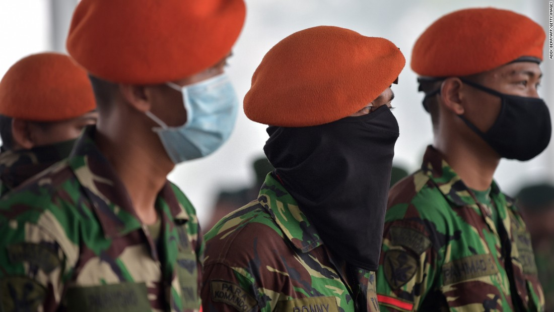 Members of the Indonesian Air Force attend a roll call at an airport before reinforcing firefighters in Pekanbaru, Indonesia, on Tuesday, September 15.