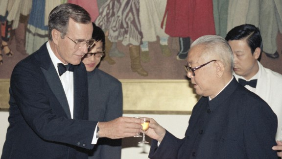 Then U.S. Vice President George H. W. Bush proposes a toast to former Chinese President Li Xiannian during a dinner at the Chinese Embassy in Washington D.C. in July, 1985. Li, the first Chinese head of state to visit the United States, hosted the dinner in Bush's honor.