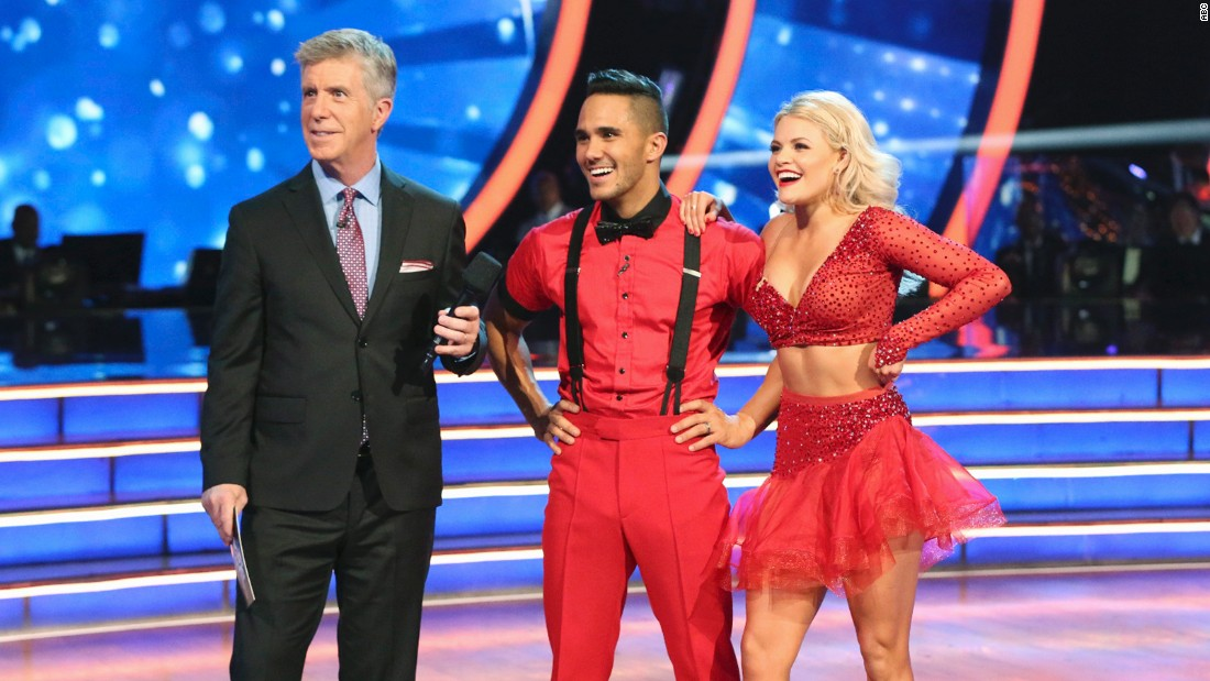 Host Tom Bergeron, left, chats with Carlos PenaVega and pro partner Witney Carson. PenaVega's wife, Alexa, was also competing on the show -- against him.