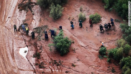 In this aerial photo searchers continue looking for 6-year-old Tyson Lucas Black in Zion National Park, Utah, Wednesday, Sept. 16, 2015. Multiple hikers who entered a narrow desert canyon for a day of canyoneering became trapped when a flash flood filled the chasm with water, killing several of them in Zion National Park in southern Utah, officials said Wednesday. (Scott G Winterton/The Deseret News via AP)  SALT LAKE TRIBUNE OUT; MAGS OUT; NO SALES; MANDATORY CREDIT
