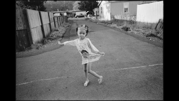 J'Lisa plays ballerina outside in 2014.