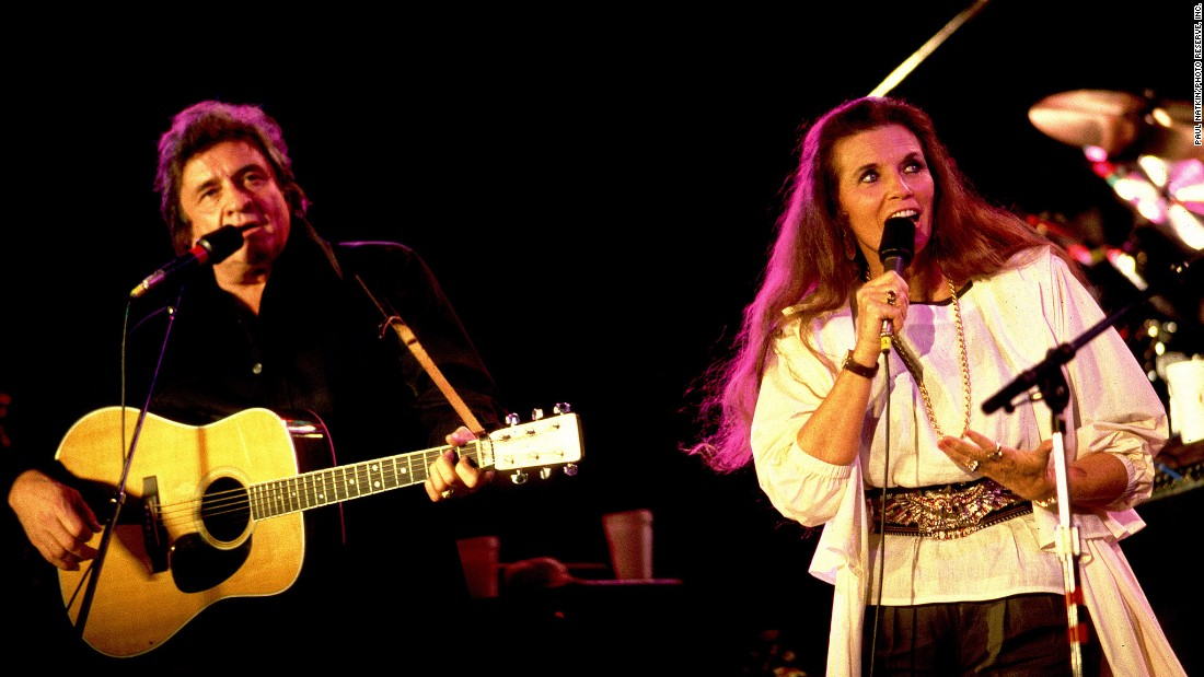 "Johnny Cash and wife June Carter perform at Farm Aid in 1985. Cash was flying high at the time, thanks to the No. 1 country song ""Highwayman,"" which he recorded with Wilson, Waylon Jennings and Kris Kristofferson. It would be his last chart-topper."