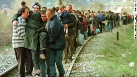 Ethnic Albanian refugees arrive by foot in Macedonia in April, 1999 after being forced off a train in Kosovo.