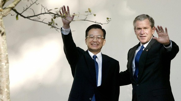 """U.S. President George W. Bush and former Chinese Premier Wen Jiabao walk along the colonnade before a meeting at the White House in Washington, D.C. on December 9, 2003. Speaking with Bush at his side in the Oval Office, Wen warned Taiwan not to seek independence, while Bush reaffirmed the so-called """"One China"""" policy of the United States, which maintained that Taiwan is a part of China."""