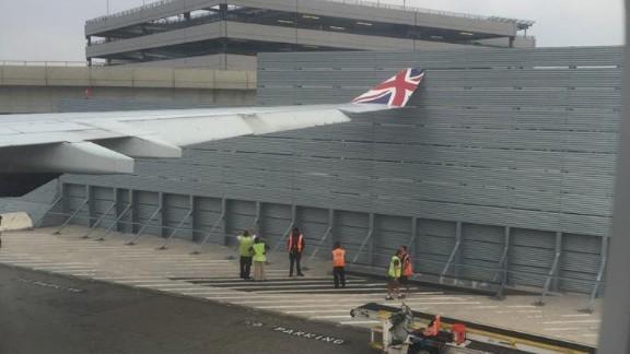 "The plane ""shuddered"" as it hit the fence, a Virgin Atlantic flight passenger said."